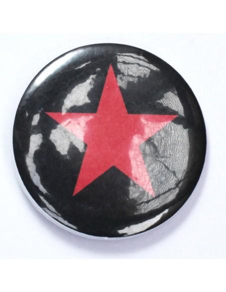 Chapa estrella roja sobre fundo negro